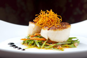 Seared King scallops, carrot hair, wilted vegetables and soy ponzu