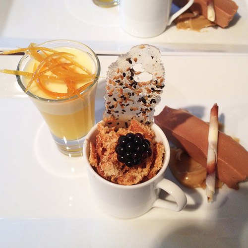 Lemon posset, coffee chocolate cup and ameretto biscuit, chocolate trio