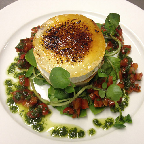 Honey glazed goat's cheese, toasted English muffin, slow roasted pepper dressing and dressed baby leaves