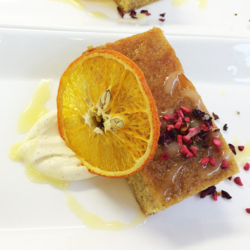 Orange and polenta cake, vanilla cream and dried orange slice
