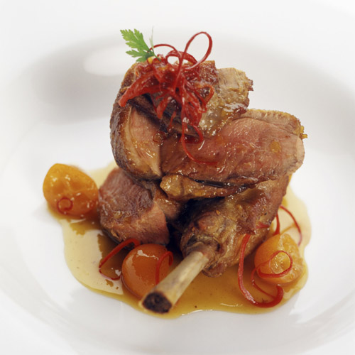 Roast duck, confit of its leg, poached kumquats, red pepper hair