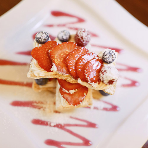 Mille feuille of strawberrys and blueberries with wild strawberry couli
