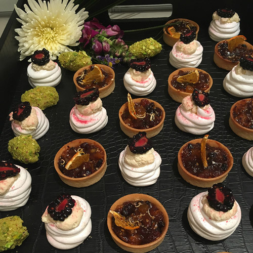 Winter mince tarts, white chocolate and pistachio curls and individual winter blackberry pavlovas