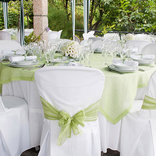Spring wedding reception table set up. Green is the colour!